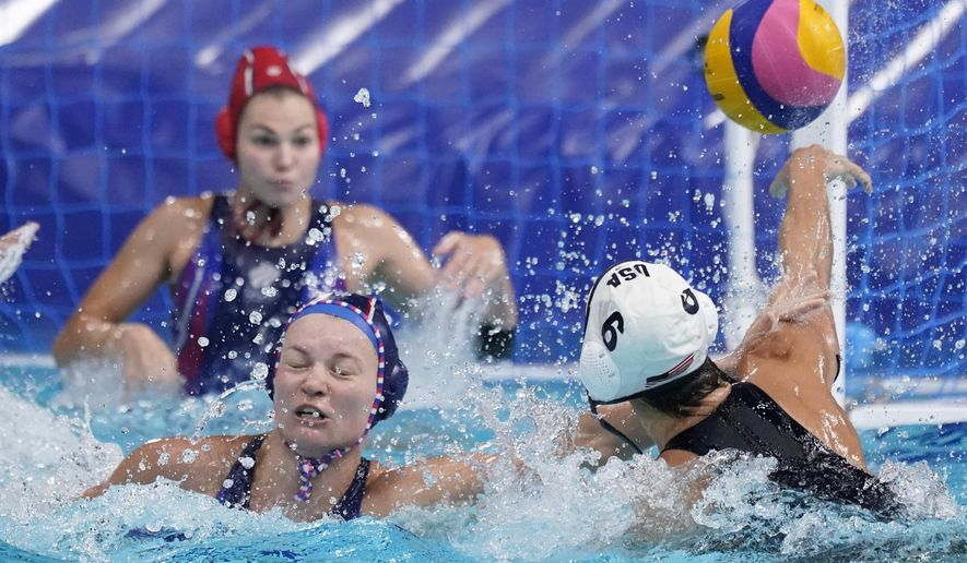 United States' Margaret Steffens (6) gets her shot away as she is defended by Evgeniya Ivanova, lower left, of the Russian Olympic Committee, during a preliminary round women's water polo match at the 2020 Summer Olympics, Friday, July 30, 2021, in Tokyo, Japan. (AP Photo/Mark Humphrey)