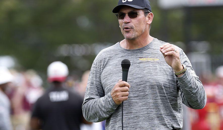 Coach Ron Rivera talks to fans during the Washington Football Team's NFL training camp Saturday, July 31, 2021, in Richmond, Va. (AP Photo/Dean Hoffmeyer)