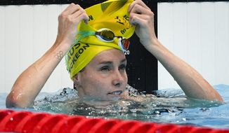 Emma Mckeon, of Australia, finishes a women's 50-meter freestyle heat at the 2020 Summer Olympics, Friday, July 30, 2021, in Tokyo, Japan. (AP Photo/Jae C. Hong)