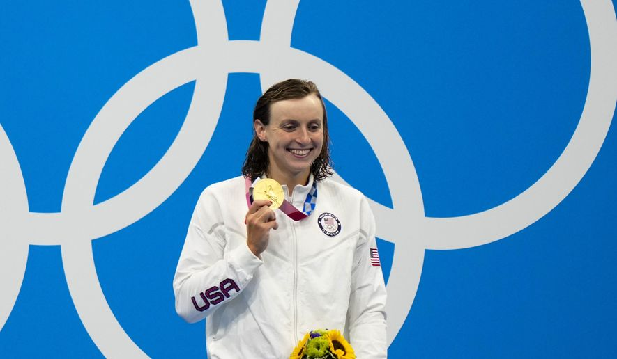 Kathleen Ledecky, of United States, poses after winning the gold medal in the women's 800-meter freestyle final at the 2020 Summer Olympics, Saturday, July 31, 2021, in Tokyo, Japan. (AP Photo/David Goldman) **FILE**