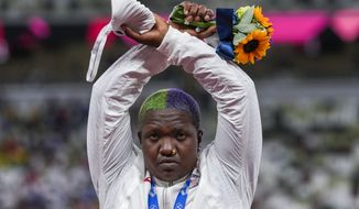 Raven Saunders, of the United States, poses with her silver medal on women's shot put at the 2020 Summer Olympics, Sunday, Aug. 1, 2021, in Tokyo, Japan.  During the photo op at her medals ceremony Sunday night, Saunders stepped off the podium, lifted her arms above her head and formed an X with her wrists. Asked what that meant, she explained: Its the intersection of where all people who are oppressed meet. (AP Photo/Francisco Seco)