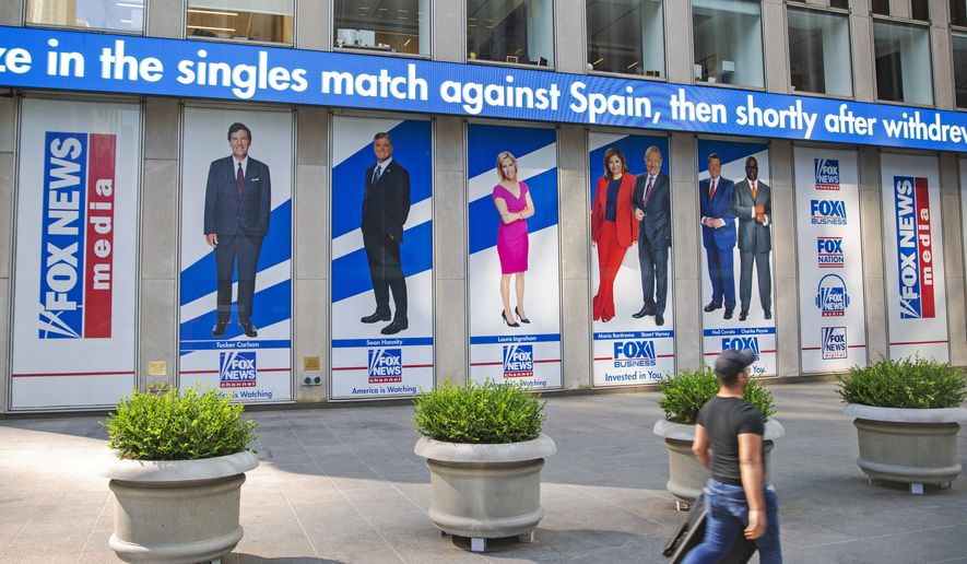 Pictured in promotional posters outside Fox News studios at News Corporation headquarters in New York on Saturday, July 31, 2021, are hosts Tucker Carlson, Sean Hannity, Laura Ingraham, Maria Bartiromo, Stuart Varney, Neil Cavuto and Charles Payne. (AP Photo/Ted Shaffrey)