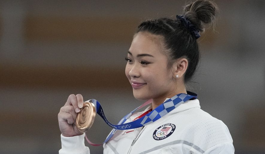 Sunisa Lee of the United States, poses after winning the bronze medal on the uneven bars during the artistic gymnastics women's apparatus final at the 2020 Summer Olympics, Sunday, Aug. 1, 2021, in Tokyo, Japan. (AP Photo/Ashley Landis)