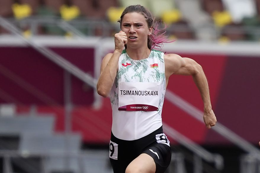 Krystsina Tsimanouskaya, of Belarus, runs in the women's 100-meter run at the 2020 Summer Olympics, Friday, July 30, 2021. Tsimanouskaya alleged her Olympic team tried to remove her from Japan in a dispute that led to a standoff Sunday, Aug. 1, at Tokyo's main airport. An activist group supporting Tsimanouskaya said she believed her life was in danger in Belarus and would seek asylum with the Austrian embassy in Tokyo. (AP Photo/Martin Meissner) **FILE**