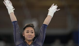 Sunisa Lee of the United States, finishes after performing on the uneven bars during the artistic gymnastics women's apparatus final at the 2020 Summer Olympics, Sunday, Aug. 1, 2021, in Tokyo, Japan. (AP Photo/Natacha Pisarenko)