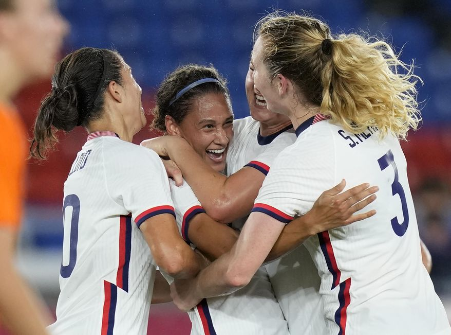 United States' Lynn Williams, center, celebrates with teammates after scoring a goal against Netherlands during a women's quarterfinal soccer match at the 2020 Summer Olympics, Friday, July 30, 2021, in Yokohama, Japan. (AP Photo/Silvia Izquierdo)