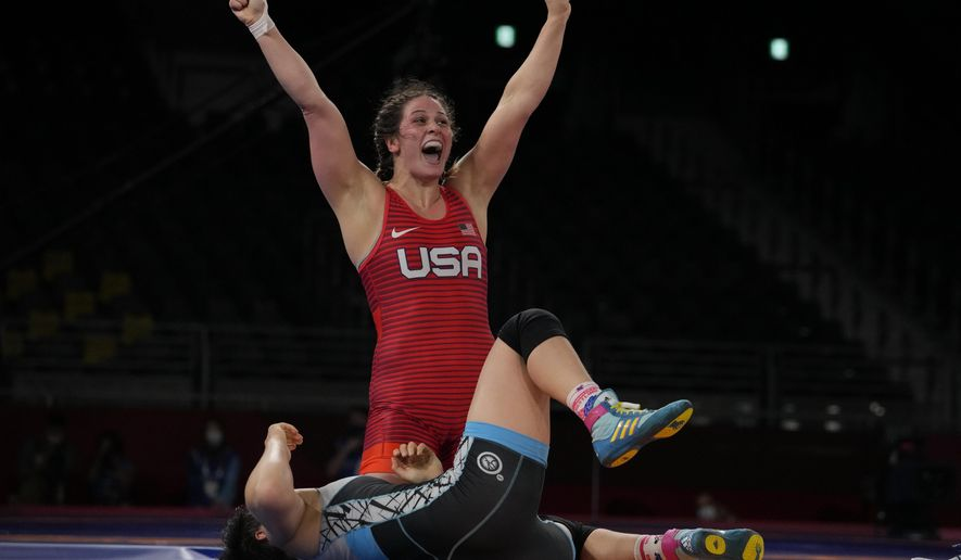 United States' Adeline Maria Gray, top, celebrates after winning against Kyrgyzstan's Aiperi Medet Kyzy during the semi-final round of the women's 76kg freestyle wrestling match at the 2020 Summer Olympics, Sunday, Aug. 1, 2021 in Chiba, Japan. (AP Photo/Aaron Favila)