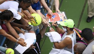 Rafael Nadal, of Spain, signs for fans as he leaves a practice session at the Citi Open tennis tournament, Saturday, July 31, 2021, in Washington. (AP Photo/Nick Wass)