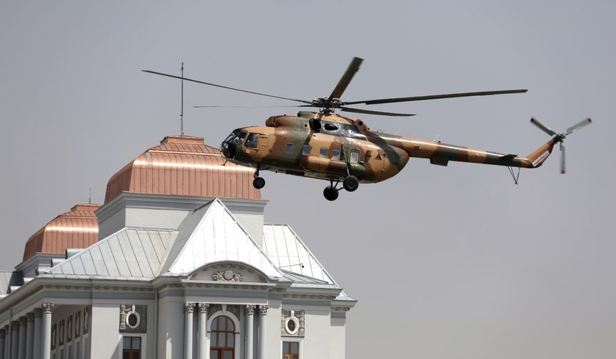 A helicopter carrying President Ashraf Ghani lands at the Darul Aman Palace in Kabul, Afghanistan, Monday, Aug. 2, 2021. (AP Photo/Rahmat Gul)