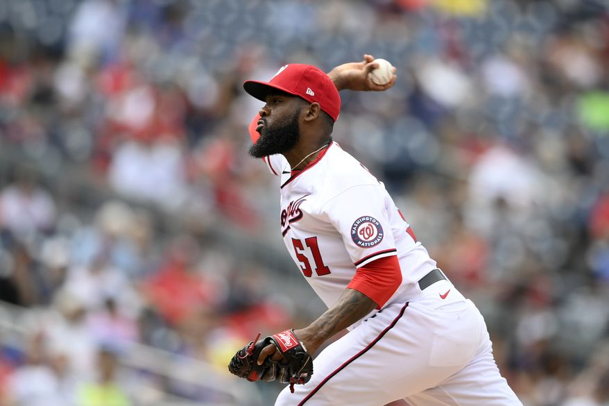 Washington Nationals relief pitcher Wander Suero (51) delivers a pitch during a baseball game against the Chicago Cubs, Sunday, Aug. 1, 2021, in Washington. (AP Photo/Nick Wass) **FILE**
