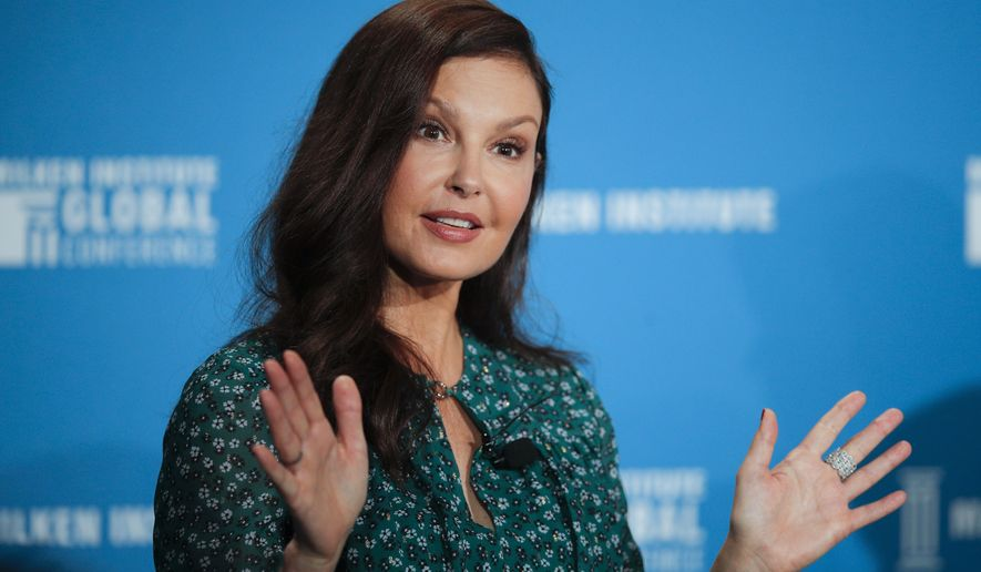 """FILE - Actress Ashley Judd speaks at the Milken Institute Global Conference in Beverly Hills, Calif., on April 30, 2018. Judd is walking again, nearly six months after shattering her leg deep in a Congolese rainforest. She tripped and fell and broke her tibia in multiple places, nearly losing her leg altogether. The actress posted a video on Instagram on Sunday where she is seen walking up a hill in a national park in the Swiss alps. She says her leg and foot """"worked beautifully."""" (AP Photo/Jae C. Hong, File)"""