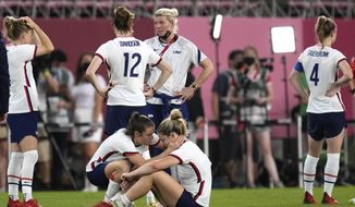 United States' Kelley O'Hara, left, talks to teammate Lindsey Horan after being defeated 1-0 by Canada during a women's semifinal soccer match at the 2020 Summer Olympics, Monday, Aug. 2, 2021, in Kashima, Japan.(AP Photo/Andre Penner)