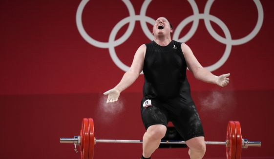 Laurel Hubbard of New Zealand reacts after dropping the barbell in a lift, in the women's +87kg weightlifting event at the 2020 Summer Olympics, Monday, Aug. 2, 2021, in Tokyo, Japan. (AP Photo/Luca Bruno)