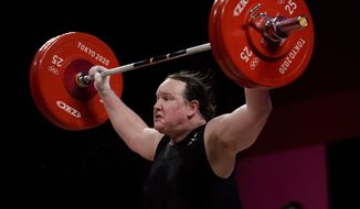 In this file photo, Laurel Hubbard of New Zealand competes in the women's +87kg weightlifting event at the 2020 Summer Olympics, Monday, Aug. 2, 2021, in Tokyo, Japan. (AP Photo/Seth Wenig)