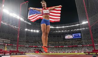 Valarie Allman, of the United States, celebrates after winning the gold medal in the women's discus throw final at the 2020 Summer Olympics, Monday, Aug. 2, 2021, in Tokyo. (AP Photo/David J. Phillip)