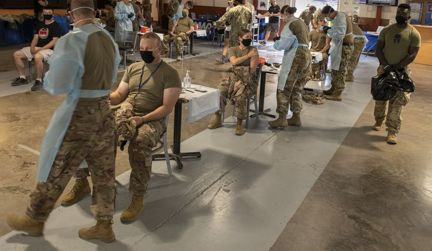 Troops get the second dose of Moderna COVID-19 vaccine during a vaccination event. (U.S. Navy photo by Mass Communication Specialist 1st Class Natalia Murillo)