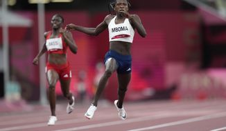Christine Mboma, of Namibia, competes in a semifinal of the women's 200-meters at the 2020 Summer Olympics, Monday, Aug. 2, 2021, in Tokyo. (AP Photo/Petr David Josek)
