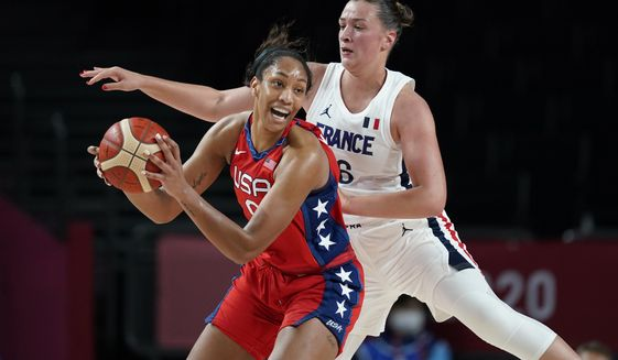 United States' A'Ja Wilson (9), left, passes ahead of France's Alexia Chartereau (6) during women's basketball preliminary round game at the 2020 Summer Olympics, Monday, Aug. 2, 2021, in Saitama, Japan. (AP Photo/Charlie Neibergall)