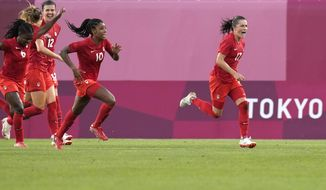 Canada's Jessie Fleming, right, celebrates scoring the opening goal from the penalty spot during a women's semifinal soccer match against United States at the 2020 Summer Olympics, Monday, Aug. 2, 2021, in Kashima, Japan. (AP Photo/Fernando Vergara)
