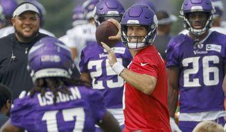 Minnesota Vikings quarterback Kirk Cousins (8) throws during a NFL training camp Friday, July 30, 2021, in Eagan, Minn. (AP Photo/Bruce Kluckhohn)