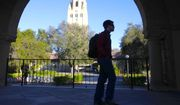 In this Wednesday, Feb. 15, 2012, photo, a student walks in front of Hoover Tower on the Stanford University campus in Palo Alto, Calif. (AP Photo/Paul Sakuma) **FILE**