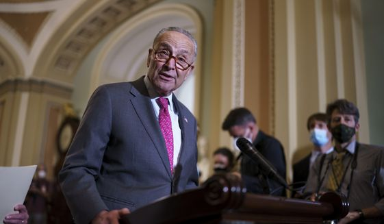 Senate Majority Leader Chuck Schumer, D-N.Y., speaks to reporters at the U.S. Capitol in Washington, Tuesday, Aug. 3, 2021.  (AP Photo/J. Scott Applewhite)  **FILE**