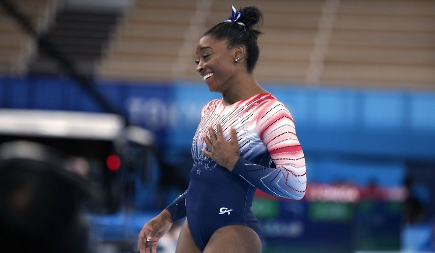 Simone Biles, of the United States, finishes on the balance beam during the artistic gymnastics women's apparatus final at the 2020 Summer Olympics, Tuesday, Aug. 3, 2021, in Tokyo, Japan. (AP Photo/Natacha Pisarenko)