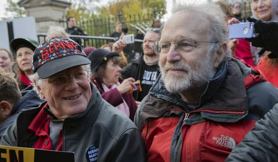 FILE - In this Nov. 8, 2019 file photo, Ben Cohen, left, and Jerry Greenfield, co-founders of Ben & Jerry's ice cream, attend a protest in Washington. The Vermont-based Ben & Jerry's has always been known for promoting social causes as much as its flavors of ice cream, but few have attracted as much attention as its decision to stop selling its ice cream in the Israeli-occupied West Bank and contested east Jerusalem. (AP Photo/Patrick Semansky, File)