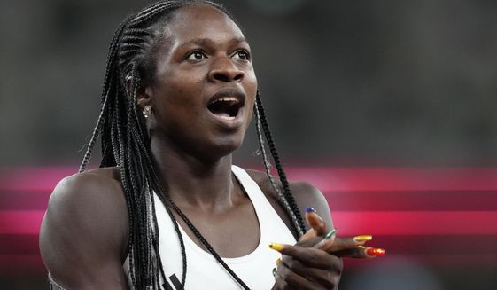 Christine Mboma, of Namibia, reacts after her second place finish in the final of the women's 200-meters at the 2020 Summer Olympics, Tuesday, Aug. 3, 2021, in Tokyo. (AP Photo/Petr David Josek)