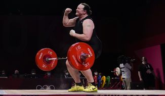 Laurel Hubbard of New Zealand reacts after a lift in the women's +87kg weightlifting event at the 2020 Summer Olympics, Monday, Aug. 2, 2021, in Tokyo, Japan. (AP Photo/Seth Wenig)