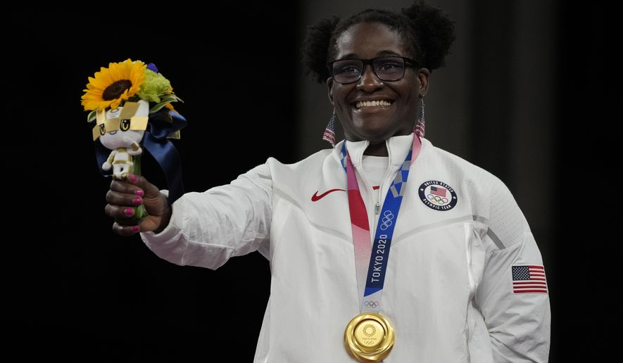 Gold medalist, United States Tamyra Marianna Stock Mensah celebrates on the podium during the medal ceremony for the women's 68kg Freestyle wrestling at the 2020 Summer Olympics, Tuesday, Aug. 3, 2021, in Chiba, Japan. (AP Photo/Aaron Favila)