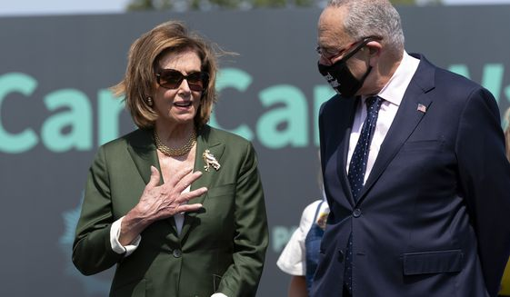 Speaker of the House Nancy Pelosi, D-Calif., speaks with Senate Majority Leader Chuck Schumer, D-N.Y., during Paid Leave for All rally on Capitol Hill in Washington, Wednesday, Aug. 4, 2021. (AP Photo/Jose Luis Magana) ** FILE **