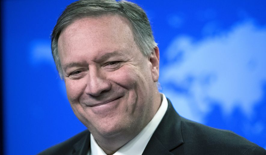 """In this Nov. 26, 2019, photo, then-Secretary of State Mike Pompeo smiles as he speaks with reporters at the State Department in Washington. The State Department says it's looking into the the apparent disappearance of a nearly $6,000 bottle of whisky given to former Secretary of State Mike Pompeo by the government of Japan. In a notice filed in the Federal Register on Wednesday, the department said it could find no trace of the bottle's whereabouts and that there is an """"ongoing inquiry"""" into what happened to the booze. (AP Photo/Alex Brandon) **FILE**"""
