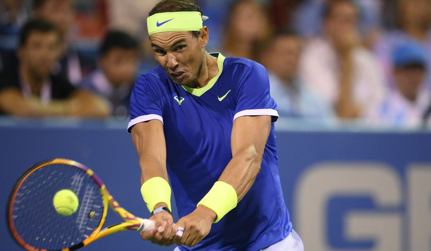Rafael Nadal, of Spain, returns a shot against Jack Sock during a match in the Citi Open tennis tournament, Wednesday, Aug. 4, 2021, in Washington. Nadal won 6-2, 4-6, 7-6 (1). (AP Photo/Nick Wass)