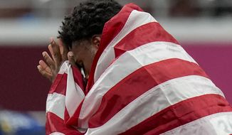Bronze medalist Noah Lyles, of the United States, reacts after the men's 200-meter final at the 2020 Summer Olympics, Wednesday, Aug. 4, 2021, in Tokyo. (AP Photo/Petr David Josek)