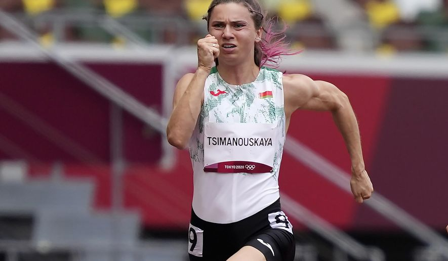 In this file photo taken on Friday, July 30, 2021, Krystsina Tsimanouskaya, of Belarus, runs in the women's 100-meter run at the 2020 Summer Olympics, Japan. A feud between Belarusian Olympic sprinter Tsimanouskaya and team officials that prompted her to seek refuge in Poland has again cast a spotlight on the repressive environment in the ex-Soviet nation, where authorities have unleashed a relentless crackdown on dissent. (AP Photo/Martin Meissner, File)