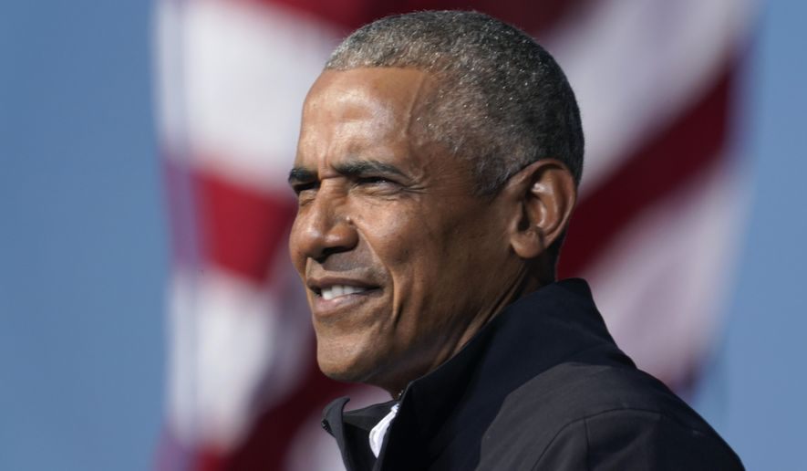 In this Nov. 2, 2020, file photo, former President Barack Obama speaks at a rally as he campaigns for Democratic presidential candidate former Vice President Joe Biden at Turner Field in Atlanta. Obama has scaled down his 60th birthday bash due to the surge in the delta variant of the coronavirus. A spokeswoman says the party planned for this weekend at his home on Martha's Vineyard is now limited to family and close friends. Obama, who turned 60 on Wednesday, had been criticized for planning a big celebration during a pandemic.  (AP Photo/Brynn Anderson)