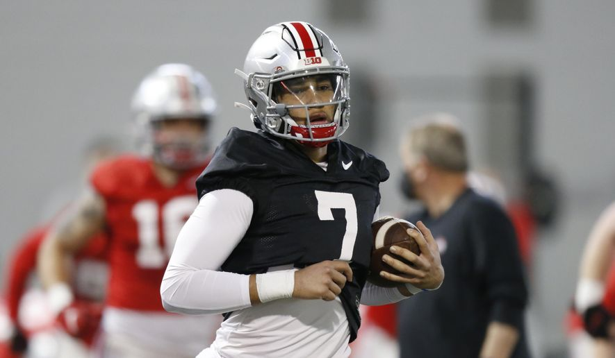 Ohio State quarterback C.J. Stroud runs through a drill during an NCAA college football practice in Columbus, Ohio, in this Monday, April 5, 2021, file photo. Third-year Ohio State coach Ryan Day opens a preseason camp for the first time without a good idea of who will be the starting quarterback. (AP Photo/Paul Vernon, File) **FILE**