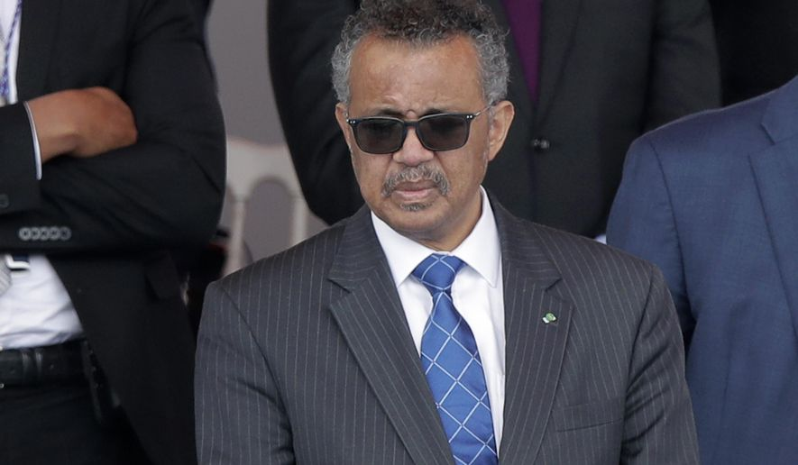 In this file photo dated Tuesday, July 14, 2020, Director-General of the World Health Organization Tedros Adhanom Ghebreyesus attends the Bastille Day military parade, in Paris.  The head of the World Health Organization has appealed on Wednesday, Aug. 4, 2021, for a moratorium on administering booster shots of COVID-19 vaccines, to ensure doses are available in countries where few people have yet received their first shots. (AP Photo/Christophe Ena, File)