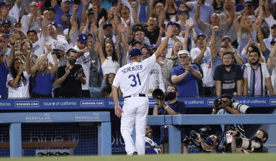 Los Angeles Dodgers starting pitcher Max Scherzer takes a curtain call during the seventh inning of a baseball game against the Houston Astros in Los Angeles, Wednesday, Aug. 4, 2021. Scherzer allowed 2 runs on 109 pitches, and struck out 10 Astro batters in seven innings of work. (AP Photo/Alex Gallardo)