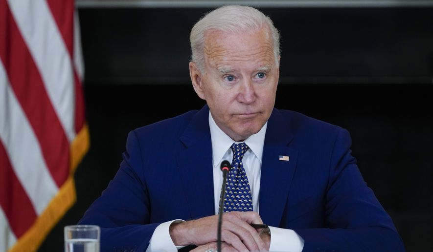 President Joe Biden listens during a meeting with Asian American, Native Hawaiian, and Pacific Islander civil rights leaders, in the State Dining Room of the White House, Thursday, Aug. 5, 2021, in Washington. (AP Photo/Evan Vucci)