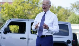 President Joe Biden speaks next to a Jeep Wrangler Rubicon 4xE during an event on clean cars and trucks, on the South Lawn of the White House, Thursday, Aug. 5, 2021, in Washington. (AP Photo/Evan Vucci)