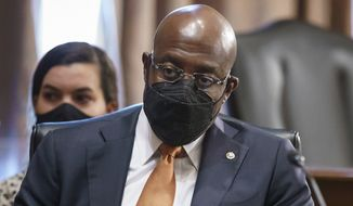 Sen. Raphael Warnock, D-Ga., a key figure on voting rights efforts, listens to testimony at a Senate Banking Committee hearing, at the Capitol in Washington, Thursday, Aug. 5, 2021. (AP Photo/J. Scott Applewhite) **FILE**