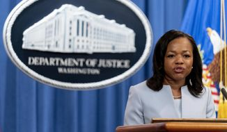 Assistant Attorney General for Civil Rights Kristen Clarke speaks at a news conference at the Department of Justice in Washington, Thursday, Aug. 5, 2021, to announce that the Department of Justice is opening an investigation into the city of Phoenix and the Phoenix Police Department. (AP Photo/Andrew Harnik) **FILE**
