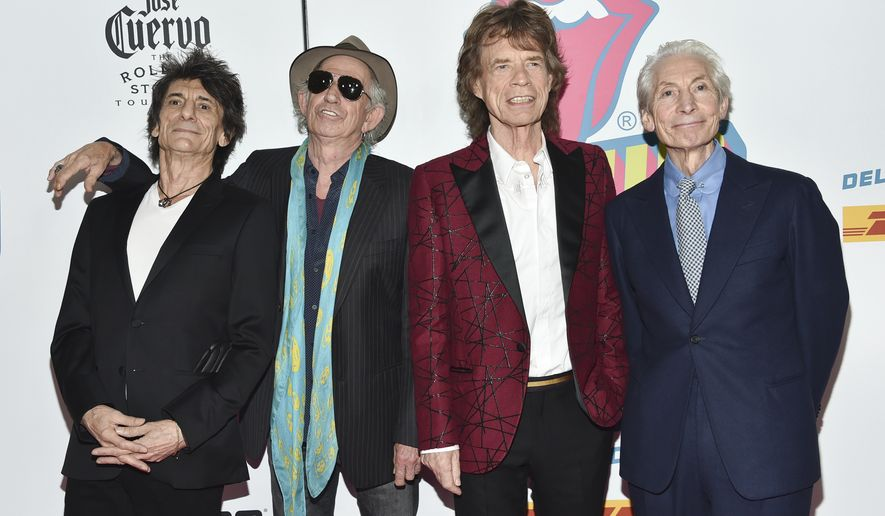"""This Nov. 15, 2016 file photo shows members of the Rolling Stones, from left, Ronnie Wood, Keith Richards, Mick Jagger and Charlie Watts at the opening night party for """"Exhibitionism"""" at Industria in New York. Watts will likely miss the bands upcoming U.S. tour to allow him to recover from an unspecified medical procedure. A spokesperson for the musician said Wednesday, Aug. 4, 2021, the procedure was completely successful but that Watts needs time to recuperate.  (Photo by Evan Agostini/Invision/AP, File)"""