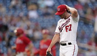 Washington Nationals relief pitcher Kyle Finnegan walks off the field in the middle of the ninth inning of a baseball game against the Philadelphia Phillies, Thursday, Aug. 5, 2021, in Washington. Philadelphia scored four runs against Finnegan in the ninth, and won 7-6. (AP Photo/Patrick Semansky)