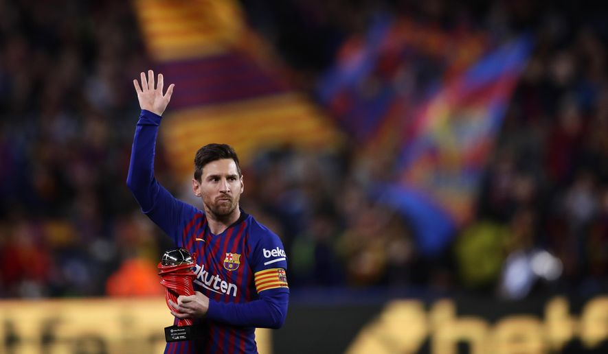 """In this Saturday, April 6, 2019, photo, Barcelona forward Lionel Messi waves at the crowd as he holds the trophy of the best Spanish La Liga player prior to a soccer match between FC Barcelona and Atletico Madrid at the Camp Nou stadium in Barcelona, Spain. Barcelona says Lionel Messi will not stay with the club, it was reported on Aug. 5, 2021, in a statement that a deal between the club and the player had been reached but financial """"obstacles"""" made it impossible for the player to remain with the club.  (AP Photo/Manu Fernandez) **FILE**"""