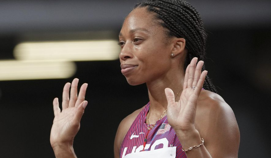 Allyson Felix, of the United States, reacts prior to the start in a semifinal of the women's 400-meters at the 2020 Summer Olympics, Wednesday, Aug. 4, 2021, in Tokyo. (AP Photo/Matthias Schrader)