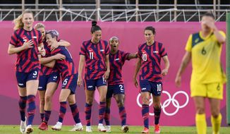 United States' Megan Rapinoe celebrates with teammates scoring her side's 2nd goal against Australia in the women's bronze medal soccer match at the 2020 Summer Olympics, Thursday, Aug. 5, 2021, in Kashima, Japon. (AP Photo/Fernando Vergara)