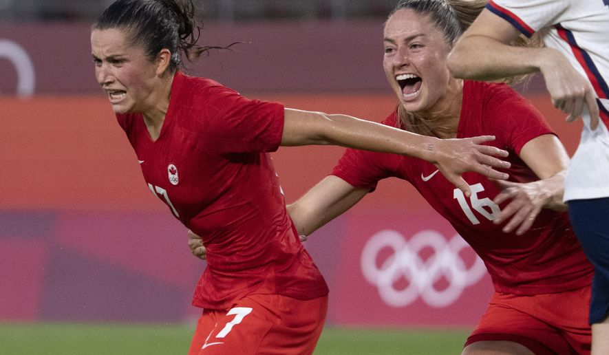 Canada midfielder Jessie Fleming (17) celebrates her game winning penalty kick goal with teammate Janine Beckie (16)  during a women's semifinal soccer match against United States at the 2020 Summer Olympics, Monday, Aug. 2, 2021, in Kashima, Japan. (Frank Gunn/The Canadian Press via AP)